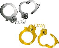 Isolated handcuffs, in steel and gold. Stock Images