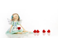 Isolated handmade doll like an angel with red hearts. Royalty Free Stock Photography