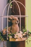 Isolated Handmade Easter Decorations & x28;Bunny with Blossom Flowers in Cage& x29; - Concept of the Harmony and Peace in Family stock photos