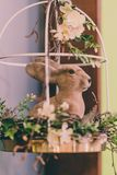 Isolated Handmade Easter Decorations & x28;Bunny with Blossom Flowers in Cage& x29; - Concept of the Harmony and Peace in Family stock photo