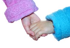 Isolated girl and boy in bath robes join their hands royalty free stock images