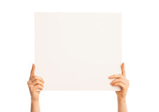 Isolated hands holding a big piece of paper Stock Photo