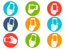 Hands holding mobile phone icons buttons set. Isolated Hands holding mobile phone icons buttons set from white background Royalty Free Stock Images