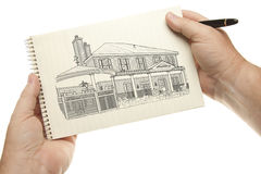 Isolated Hands Holding Pen and Paper with House Drawing Stock Photography