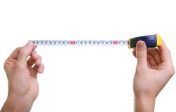 Isolated hands measuring using tape measure Royalty Free Stock Image
