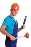 Isolated handyman with wrench and plunger Royalty Free Stock Image