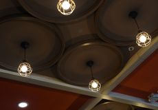 Isolated hanging ceiling lights of a restaurant photograph stock photo