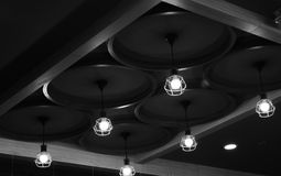 Isolated hanging ceiling lights of a restaurant photograph stock photography