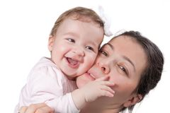 Happy baby girl and mother smiling Isolated  on wh. Isolated happy baby girl and her mother smiling on white background Stock Images