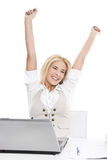Isolated happy blond woman in office Royalty Free Stock Image