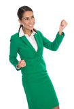 Isolated happy business woman in green celebrating her success. Stock Images