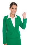 Isolated happy businesswoman in green showing something with her. Isolated pretty smiling businesswoman in green showing something with her hands Stock Image