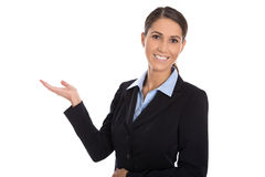 Isolated happy businesswoman presenting and showing over white b Stock Photos