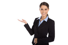 Isolated happy businesswoman presenting and showing over white b Royalty Free Stock Photo