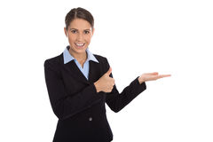 Isolated happy businesswoman presenting and showing over white b Royalty Free Stock Images