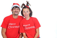 Isolated happy christmas couple hamming Royalty Free Stock Photography
