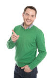 Isolated happy man in green presenting with forefinger. Royalty Free Stock Photos