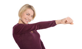 Isolated happy mature woman with outstretched arm and fist. Successful older woman with outstretched arm and fist isolated on white Stock Images