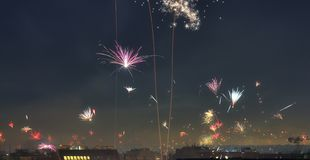 Isolated happy new year fireworks over the roofs of Vienna in Austria stock photo