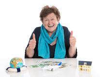 Isolated happy senior woman or pensioner - money concept for tra Royalty Free Stock Image