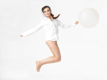 Isolated happy woman jumping with balloon Royalty Free Stock Images