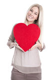 Isolated happy young blond caucasian woman Holding red heart. Stock Photography
