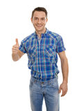 Isolated happy young man in blue with thumbs up. Stock Photo