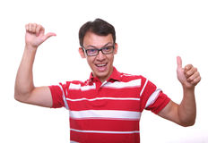 Isolated happy young man in red. With glasses Royalty Free Stock Photos