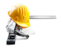 Isolated hard hat with tools and blueprint on whit Royalty Free Stock Photo