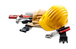 Isolated hard hat with tools and blueprint on whit Royalty Free Stock Images