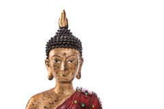 Isolated head of a buddha in red, black and golden color. Royalty Free Stock Photos