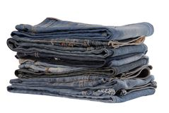 Isolated heap of blue jeans, pile of jeans-wear is on white. Isolated heap of blue jeans, a pile of jeans-wear is on white Royalty Free Stock Photos