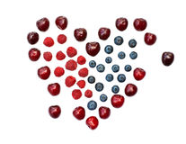 Isolated heart of cherry, blueberry and raspberry royalty free stock photography