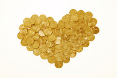 Isolated heart made of gold coins Stock Image
