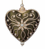 Isolated heart shaped Christmas decoration. Isolated green velvet embroidered Xmas decoration in the shape of a heart royalty free stock photos