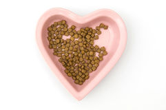 Isolated Heart Shaped Dog Food Bowl Stock Photo