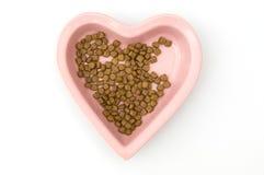 Isolated Heart Shaped Dog Food Bowl Stock Photo