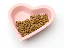Isolated Heart Shaped Dog Food Bowl. Heart Shaped Dog Food Bowl Isolated Against White Background Royalty Free Stock Images