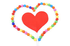 Isolated heart stick framed with colorful sweets Royalty Free Stock Images