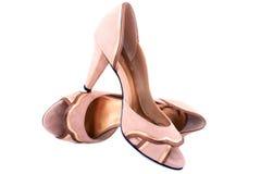 Isolated high-heeled beige shammy shoes. Close-up isolated high-heeled beige shammy shoes royalty free stock image