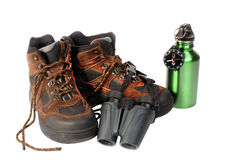 Isolated hiking equitment. Hiking boots with binoculars compass and water bottle Royalty Free Stock Photography
