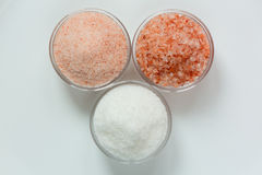 Isolated himalayan pink salt, and white sea salt in the glass bowls Royalty Free Stock Image