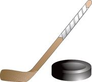Isolated hockey puck and stick. Isolated picture of a hockey puck and a hockey stick Royalty Free Stock Photos