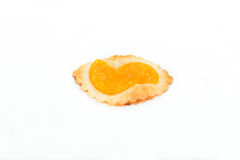 Isolated homemade orange pastry on wood board Royalty Free Stock Photo
