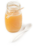 Isolated honey jar with spoon Stock Image