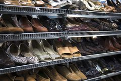 Women`s Neutral Colored Pumps, Shoes, Sandals, on Thrift Store Shelves stock photography