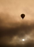 An isolated hot air balloon. Hot air balloon in a dramatic sky stock images