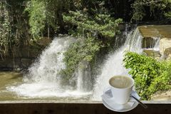 Isolated Hot coffee Put a glass of white with a casual break fro. M work background waterfall with clipping path , Thailand royalty free stock photo