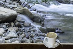 Isolated Hot coffee Put a glass of white with a casual break fro. M work background waterfall with clipping path , Thailand stock images