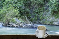 Isolated Hot coffee Put a glass of white with a casual break fro. M work background waterfall with clipping path , Thailand royalty free stock photos